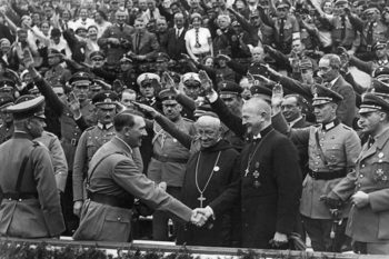 Lutheran Bishop Ludwig Muller, leader of the Reich Church in Germany, greets Hitler